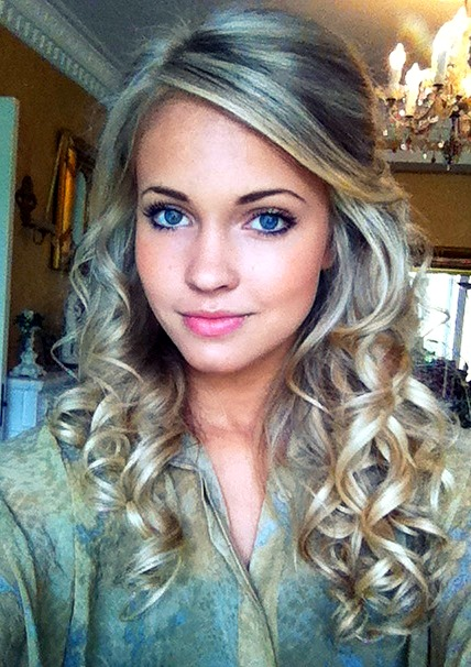 Long blonde hair, big blue eyes, by other girls she is despised. TSM.