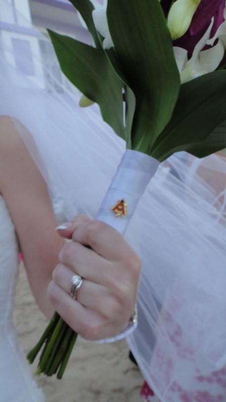 14. My biological and sorority sister wearing my pin on her bouquet as her something borrowed. TSM.